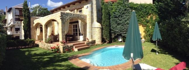 Our villa Melody's garden and swimming pool