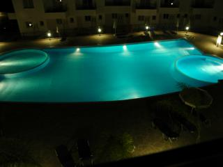 View from balcony of pool in evening