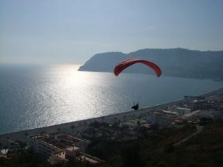 Paragliding over La Herradura Bay