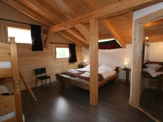 Bedroom 1, Chalet Pomet, a large Chalet in Morillon, The Grand Massif, Catered or Self Catered