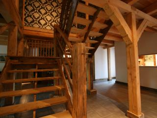 Sweeping handcrafted staircase, Chalet Pomet, a large Chalet in Morillon, The Grand Massif