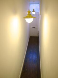 The corridor to the street exit with newly installed oak wood floors.