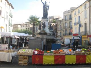 buy fresh food at the local market in Pezenas
