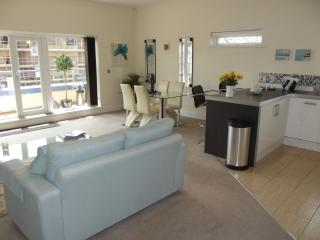 Fully carpeted, 2 two seater sofas, dining table with four chairs, breakfast bar, TV, Sky & DVD