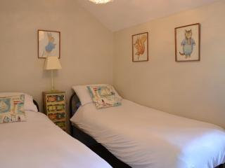 Beatrix Potter theme twin-bedded room, a favourite with the children