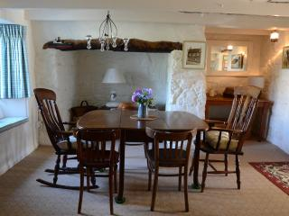 Elegant dining area of Living Room with window seat and inglenook