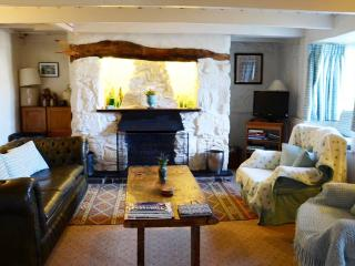 Cosy sitting area of living room with pig table and open fireplace